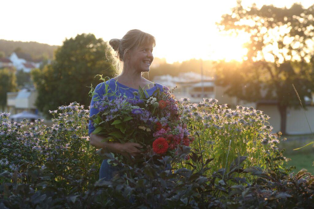 Å plante blomster